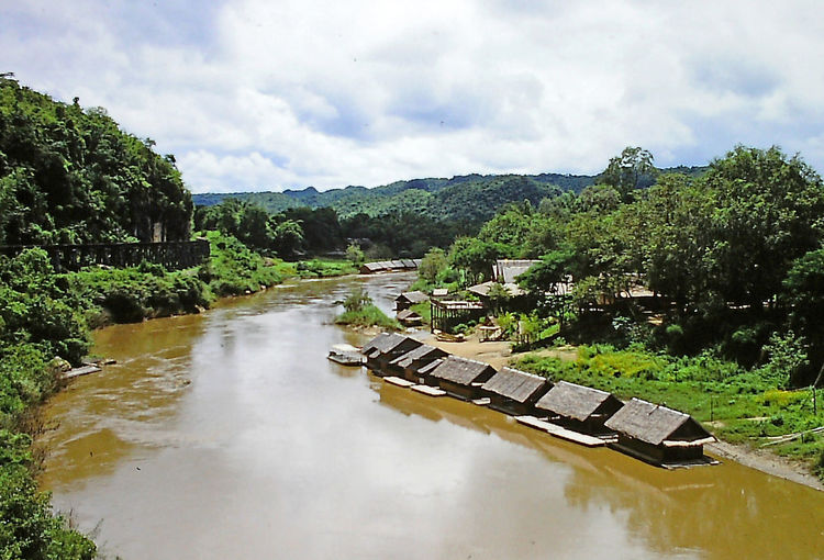 Floating dwellings on the River Kwai - Thailand Architecture River Water Nature Sky Tree Day Outdoors Thailand Tranquility Mountain River Kwai Scenics Beauty In Nature No People Cloud - Sky Built Structure Bridge - Man Made Structure Perspectives On Nature