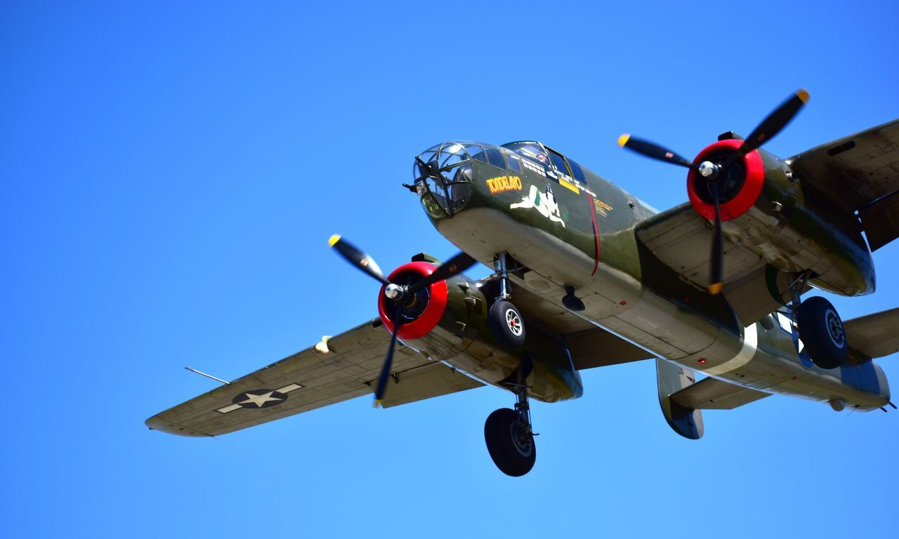 B-25 Mitchell WWII aircraft. Air Vehicle Flying Clear Sky Military Airplane Motion Day Helicopter Transportation Blue Low Angle View Outdoors Mid-air Military Airplane Aerospace Industry No People Airshow Sky No Budget Photography