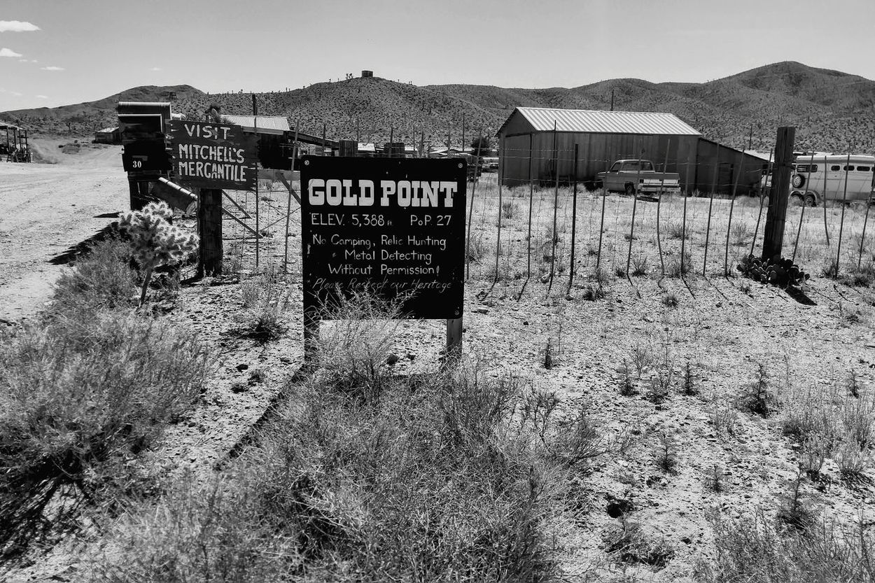 Visit, Gold Point, Nevada USAThe Oaks Trails Photos Oakstrails Photos The Oaks Trails EyeEm Best Shots Back To Black! Sky No People Text Day Outdoors Mountain History Through The Lens  Desert Mountain History Historical Landmarks Gold Mining Town Ghost Town Gold Point, NV USA Text Deserts Around The World Mountain Range Desert Sand Ghost Town Sign Population Buildings & Sky Welcome To Black EyeEmNewHere Long Goodbye Mix Yourself A Good Time The Week On EyeEm Second Acts Black And White Friday