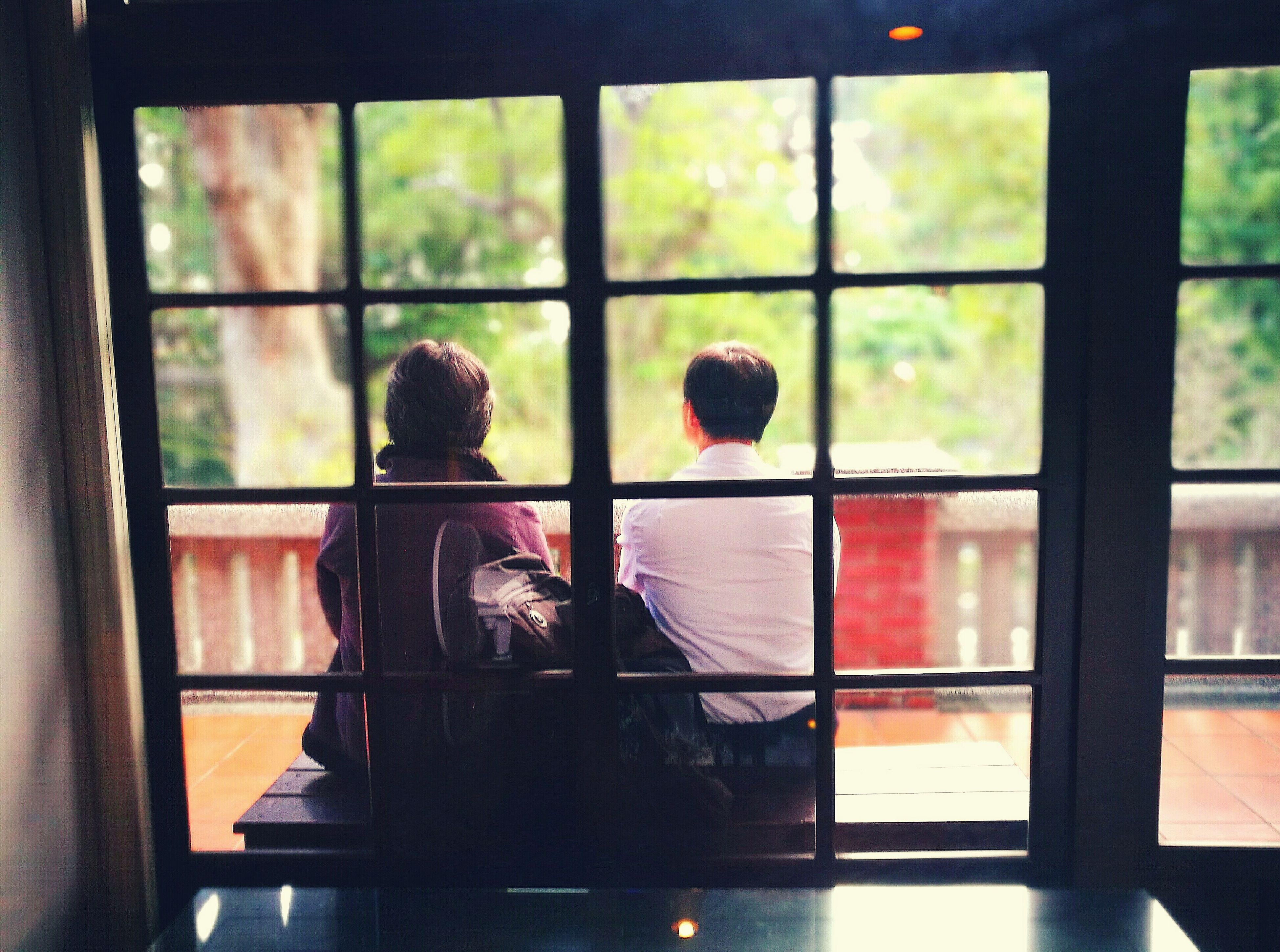 window, two people, indoors, rear view, real people, childhood, people, togetherness, adult, day