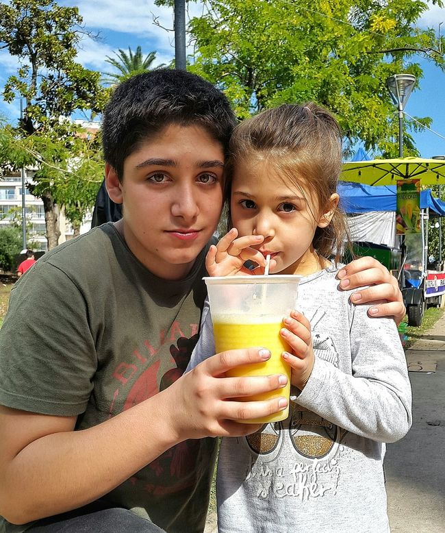 Two People Two Twoface Two Kids My Kids My Kids #^_^ My Kids Are Awesome Kidsphotography Kids Being Kids Kids Photography Kidsportrait Kids Drink Drinking Juice Drinking Juce Drinking Juices Oranje Juice Juices Juice Drink Time Oranje Big Juice Beautiful Kid Beautiful Kids
