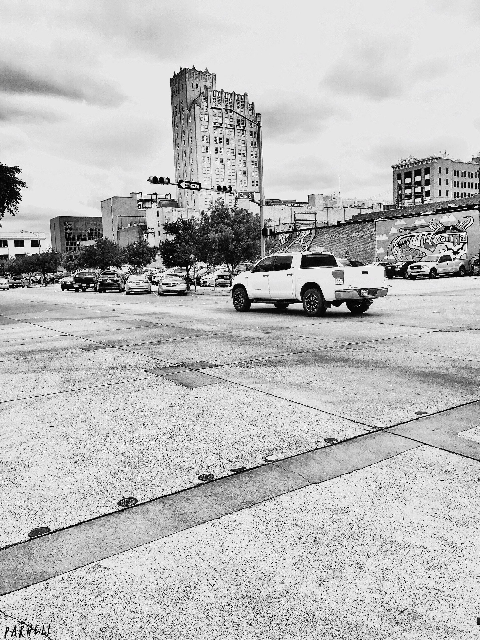car, architecture, built structure, transportation, building exterior, land vehicle, sky, mode of transport, city, road, cloud - sky, outdoors, day, no people, skyscraper