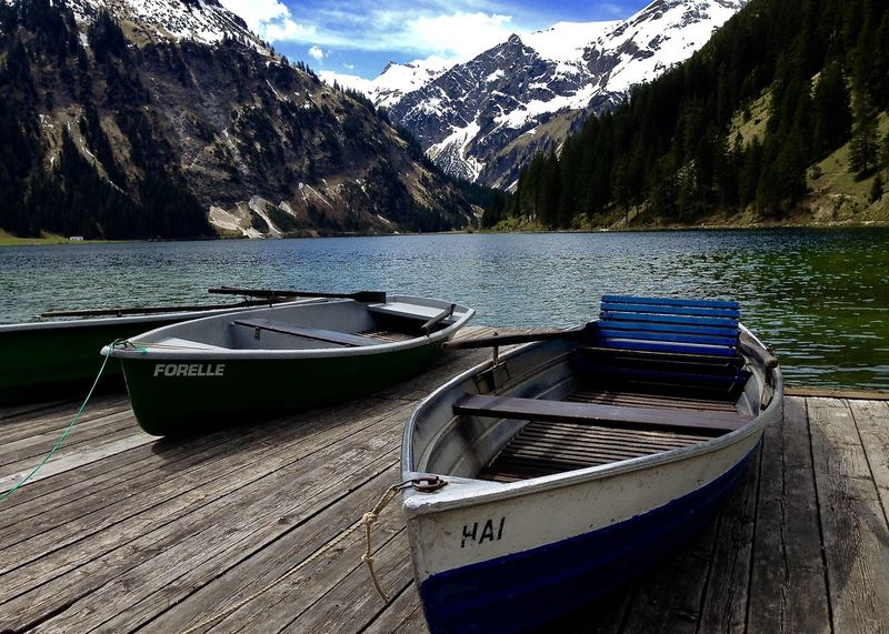 boats on jetty against amazing alps panorama, vilsalpsee, tannheimer tal, tirol Amazing Nature Beauty In Nature Boat Colors Holiday Lake Moored Mountain Mountain Range Nature Nautical Vessel Outdoors Scenics Sky Snow Snowcapped Mountain Spring Tannheimer Tal Tirol  Tranquility Tree Vilsalpsee Water Wood - Material Let's Go. Together. Let's Go. Together. EyeEm Selects