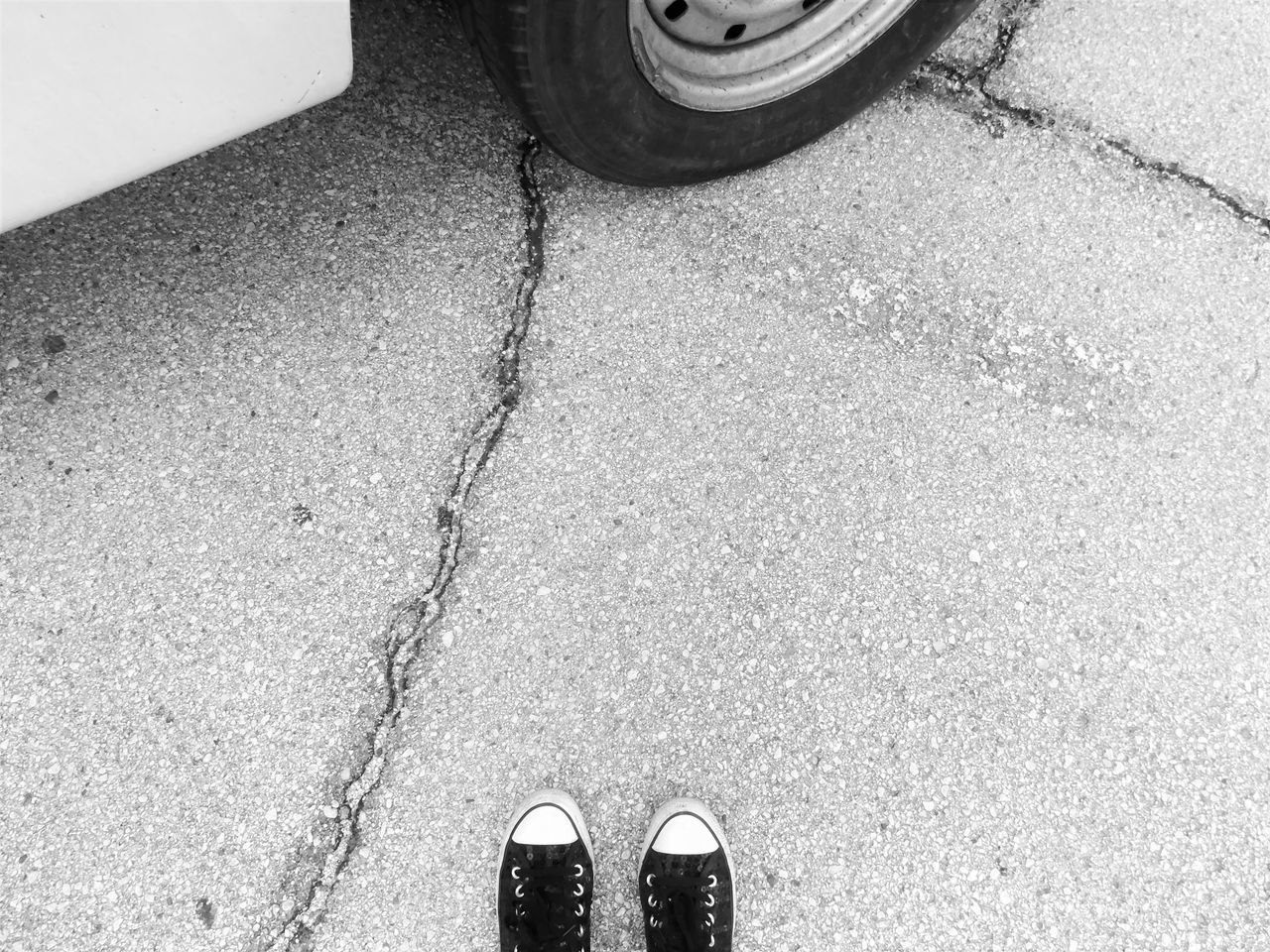 Close-up Day Low Section Monochome Photography Outdoors People Person Real People Blackandwhite Random Acts Of Photography Light And Shadow Darkness And Light Shoes Me Concrete Jungle Converse Converse Shoes My Unique Style Tire Florida Notes From The Underground Lifestyles Streetphotography Cracked Ground From My Point Of View