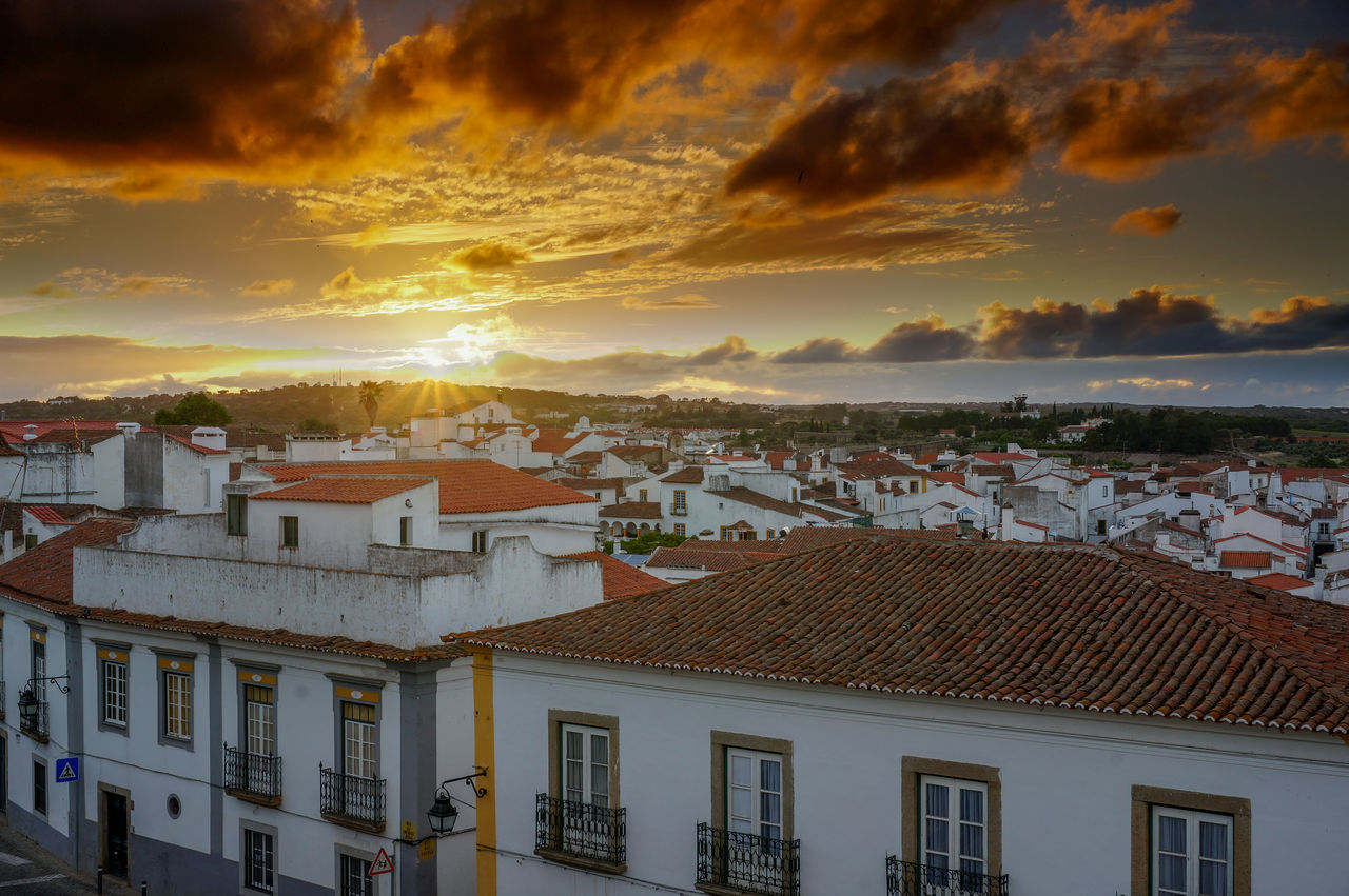 Sunset View from local known Miradouro over part of Evora with it's Roman build aquaduct. Ancient Architecture Beautiful Built Structure City Cityscape Cloud - Sky Dark Clouds Miradouro No People Portugal Red Roofs Roof Sunset Town Viewpoint White House Évora