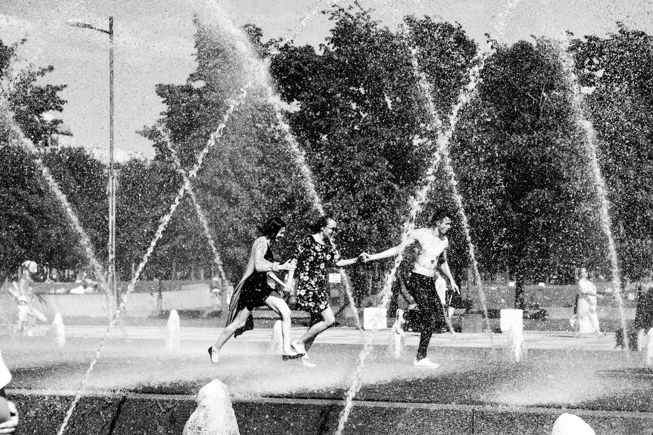 Blurred Motion Boys Childhood Day Enjoyment Excitement Fountain Fun Leisure Activity Lifestyles Long Exposure Motion Outdoors People Playing Real People Speed Splashing Spraying Sprinkler Togetherness Tree Water Water Park Water Slide