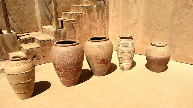 Pots Claypot Clay Work Desert Life Ruins Remenants Brown Shapes And Sizes In A Line Stairs Days Gone By Five Sand No People Color Palette