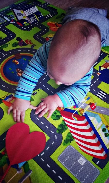 Baby Babyboy Childhood Colorful Curiosity Fingers Fun Funny Hair Hands Happiness Heart Love Multi Colored Play Mat Playing Red Heart Road