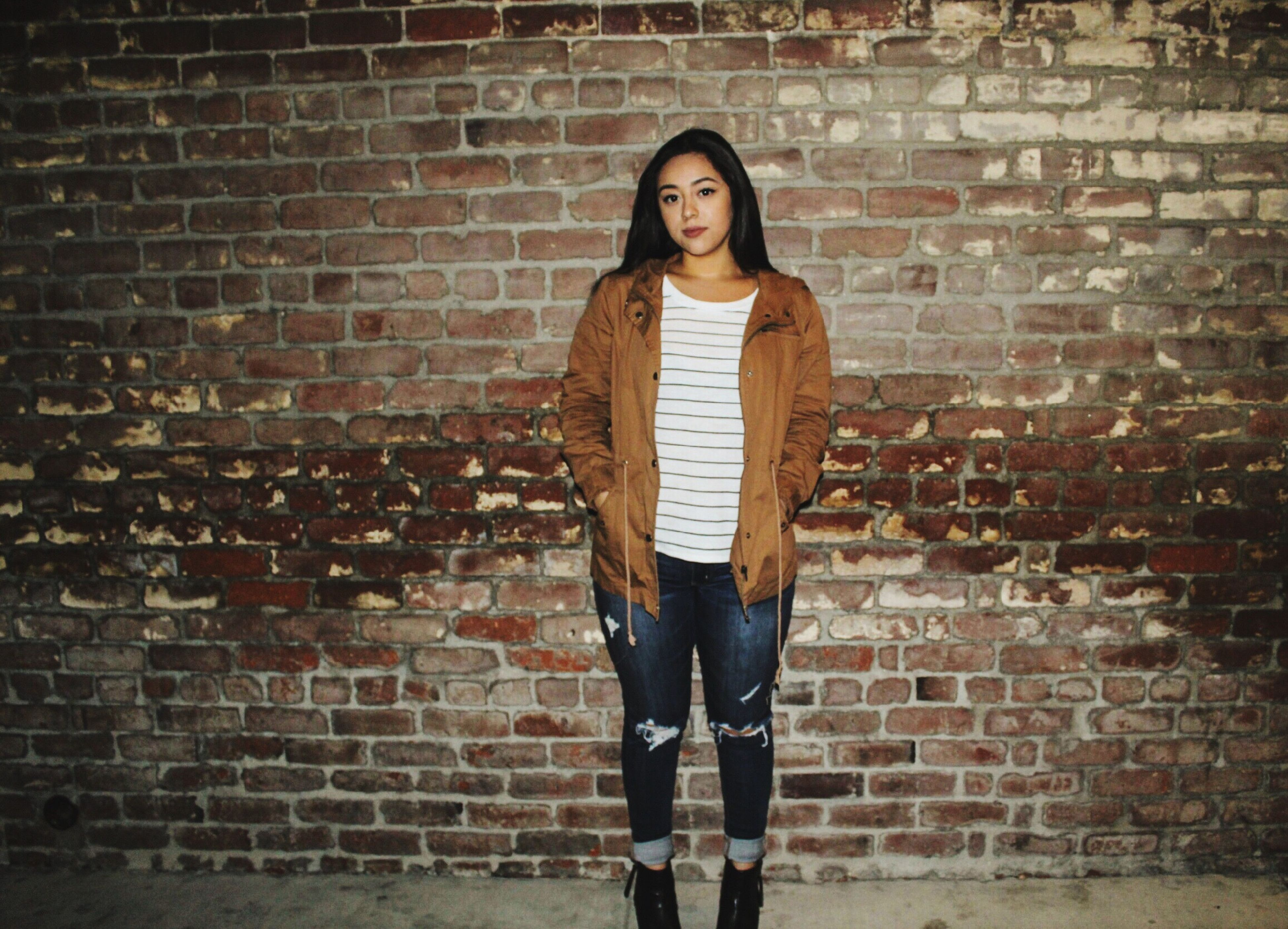 young adult, casual clothing, young women, front view, person, portrait, brick wall, looking at camera, standing, lifestyles, wall - building feature, architecture, built structure, building exterior, full length, leisure activity, fashion