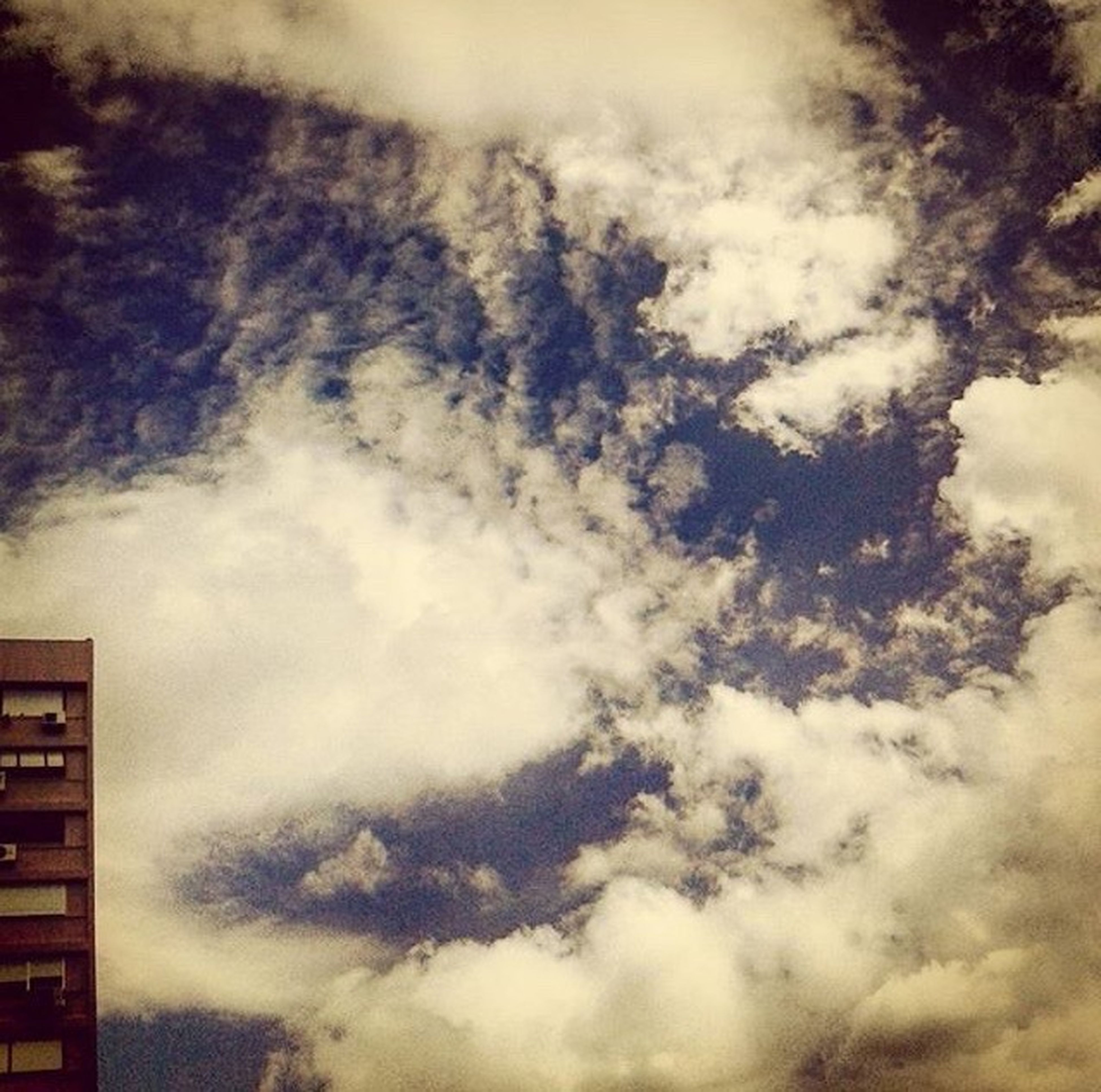 sky, cloud - sky, low angle view, cloudy, weather, beauty in nature, cloudscape, nature, scenics, tranquility, sky only, overcast, cloud, backgrounds, tranquil scene, outdoors, storm cloud, no people, idyllic, dramatic sky