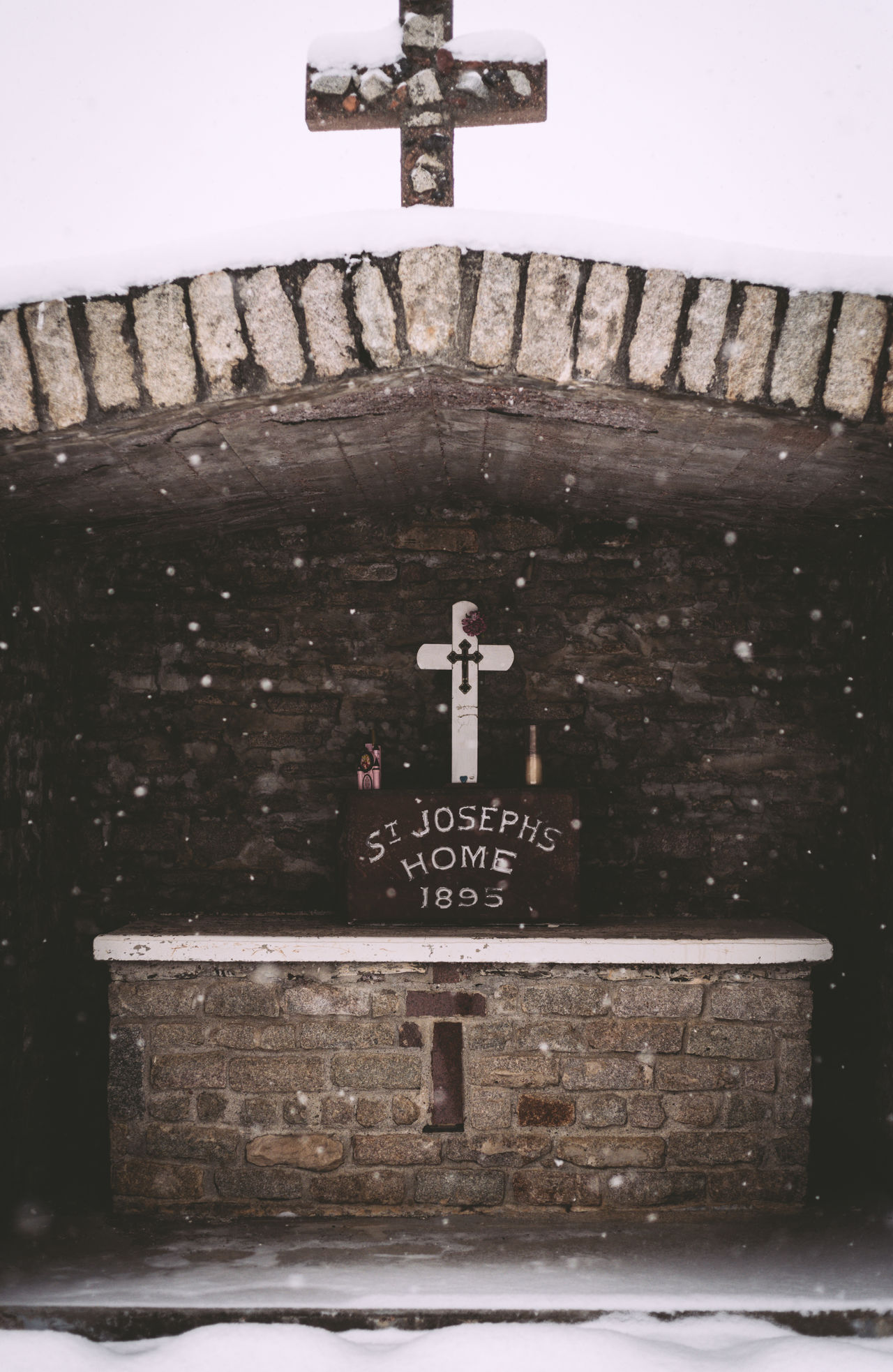 Architecture Built Structure Cross Cross Crucifix Day Heavy Snow Monument No People Outdoors Place Of Worship Religion Snow Flakes Snowing Spirituality