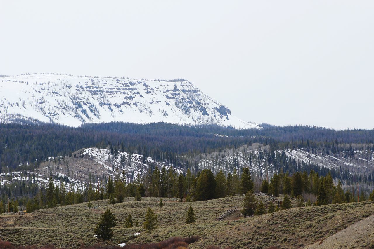 Wyoming Mountains And Sky Mountain Pine Tree Wooden Fence Snow Sagebrush Valley