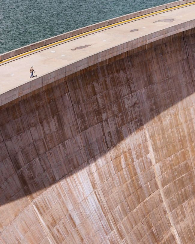 A man at the dam. Industrial Landscapes Industrial Architecture Dam Coloradoriver Minimalism Overwhelming Manvsnature  Design People And Places