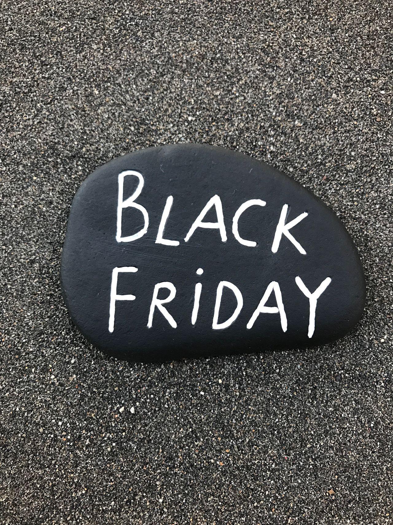 Black Friday day on a black stone Black Friday Black Friday Day Stone Sale Marketing Background Commerce Sold Sand
