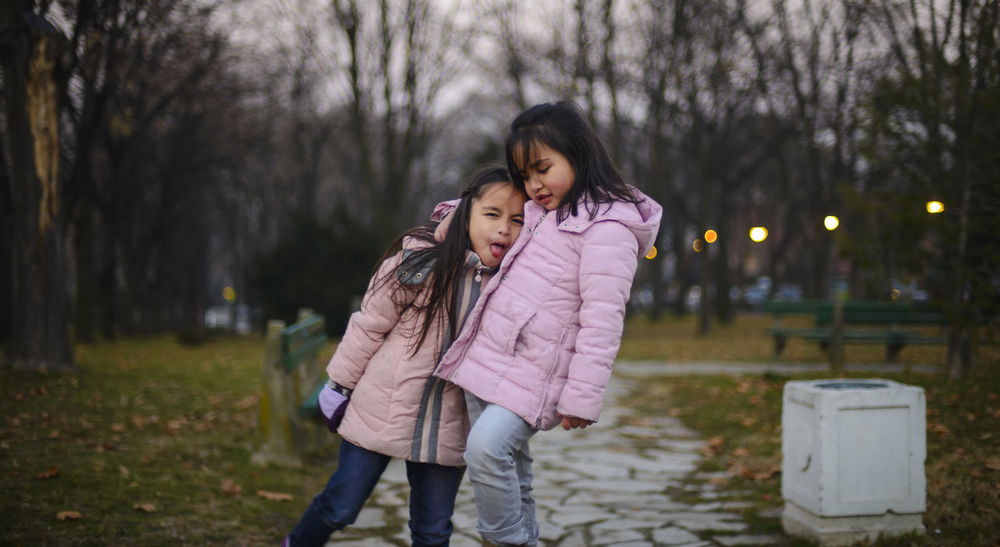 Adult Autumn Child Friendship Girls Girlswithtattoos Happiness Nature Outdoors Park People Siblings Smiling Togetherness Twins Two People Warm Clothing