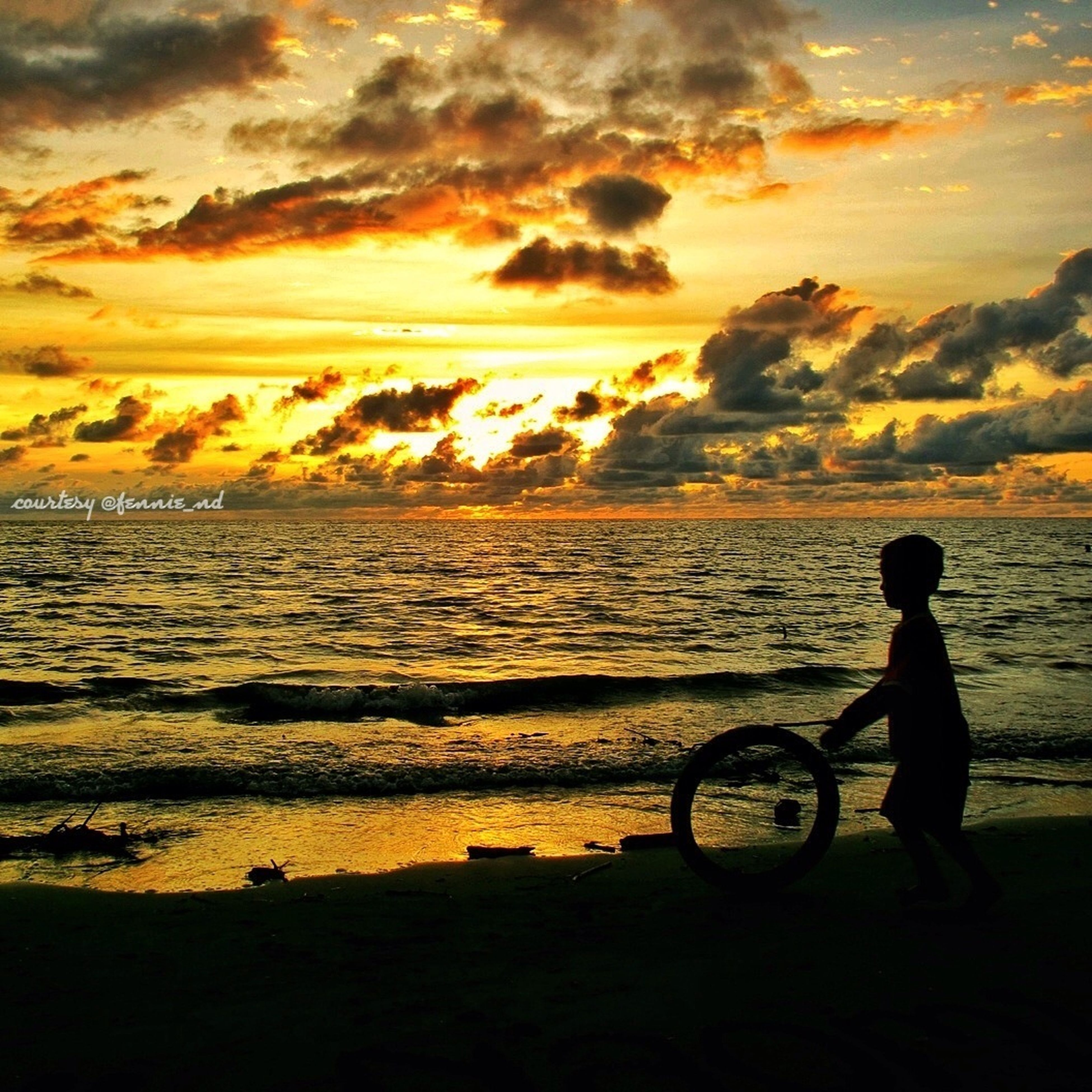 sunset, water, sea, sky, silhouette, leisure activity, lifestyles, bicycle, horizon over water, beach, men, cloud - sky, shore, transportation, mode of transport, scenics, beauty in nature, full length
