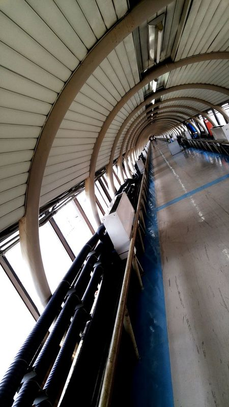 Indoors  No People Close-up Day Perspective Curves And Lines Longway Airport Rail Link Airport Bangkok Thailand Bangkok Totheend Walkway Passenger Boarding Bridge Architecture Built Structure Indoors