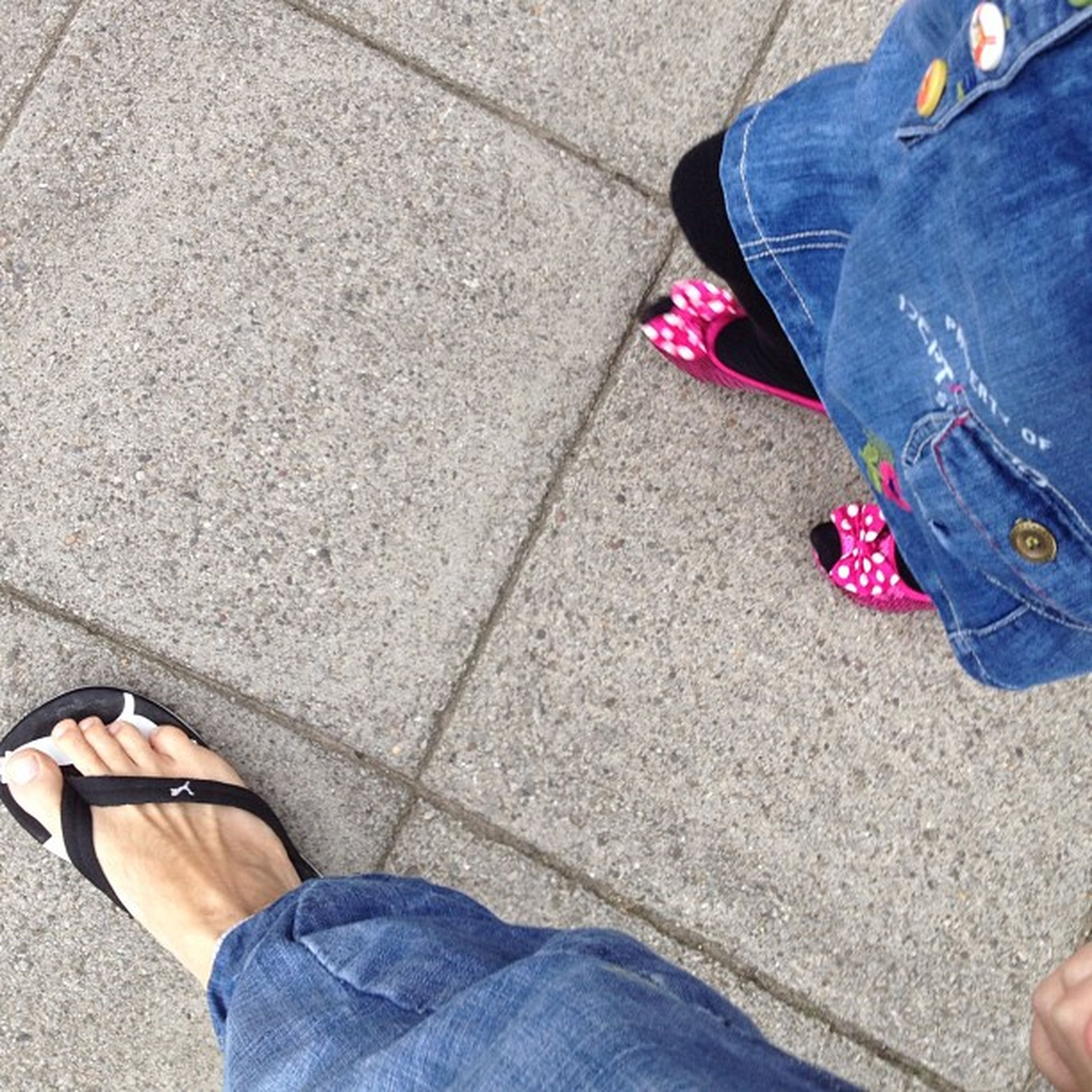 low section, person, lifestyles, men, shoe, leisure activity, standing, high angle view, casual clothing, street, togetherness, personal perspective, jeans, human foot, footwear