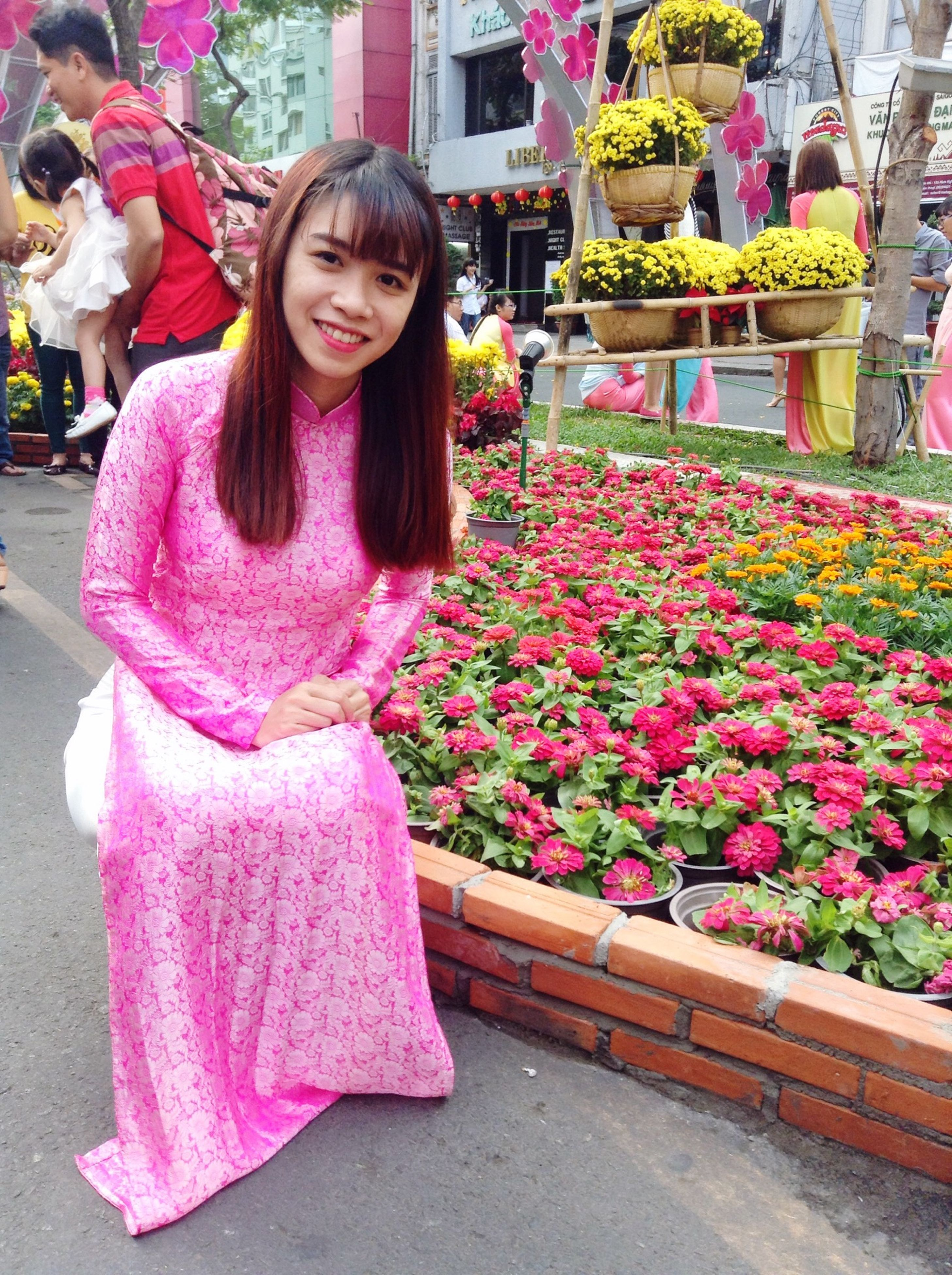 person, casual clothing, flower, lifestyles, looking at camera, front view, smiling, leisure activity, standing, portrait, young women, full length, young adult, happiness, girls, traditional clothing, freshness, dress