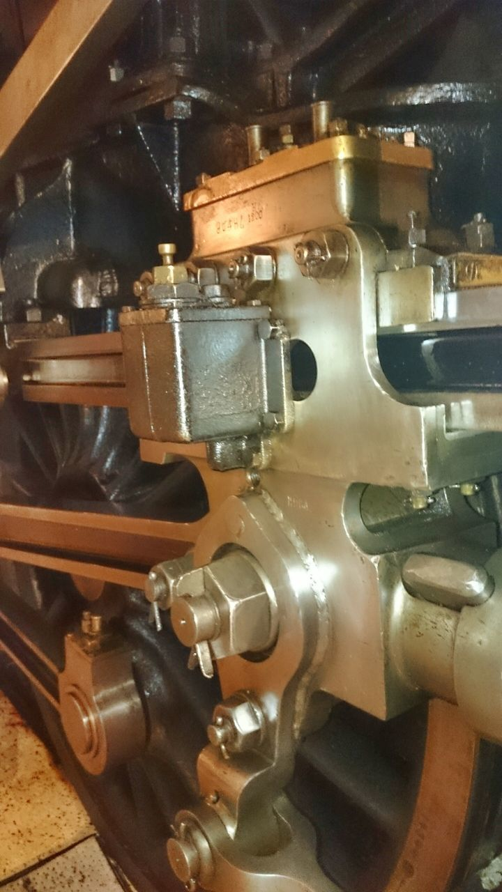 machinery, machine part, metal, no people, wheel, close-up, manufacturing equipment, engine, indoors, gear, technology, factory, steam train, locomotive, day