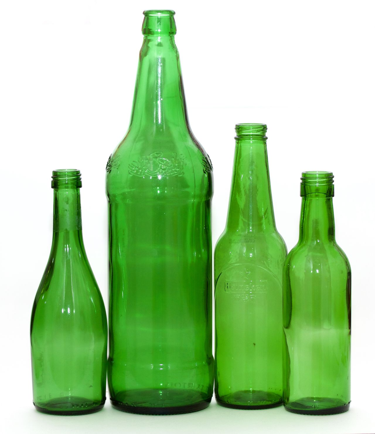 four green bottles on white background Bottle Close-up Food Green Bottles Green Color Industry No People Research Science Shape Shiny Studio Shot White Background