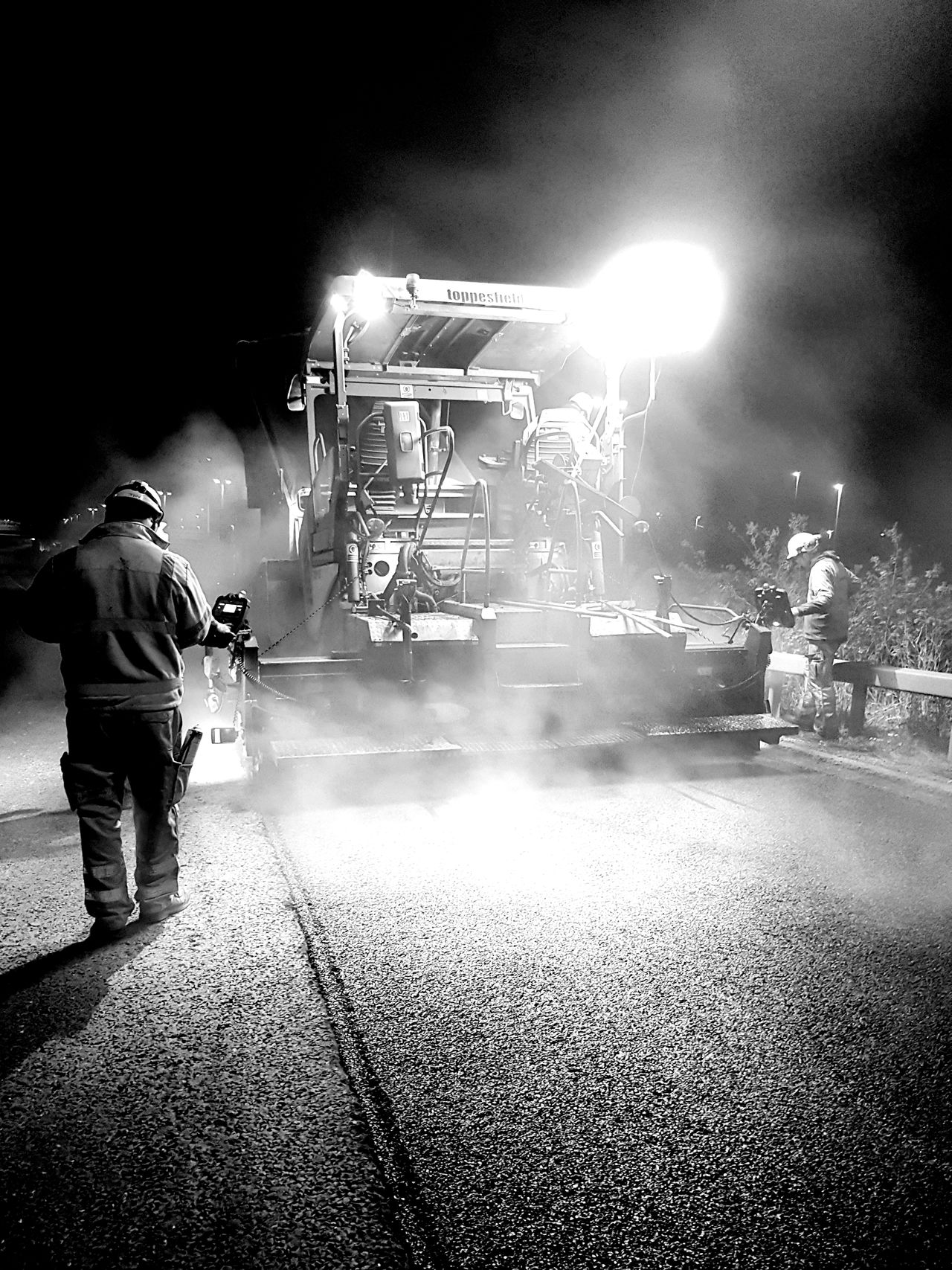 Night Construction Works Surfacing Workers. Black And White Photography