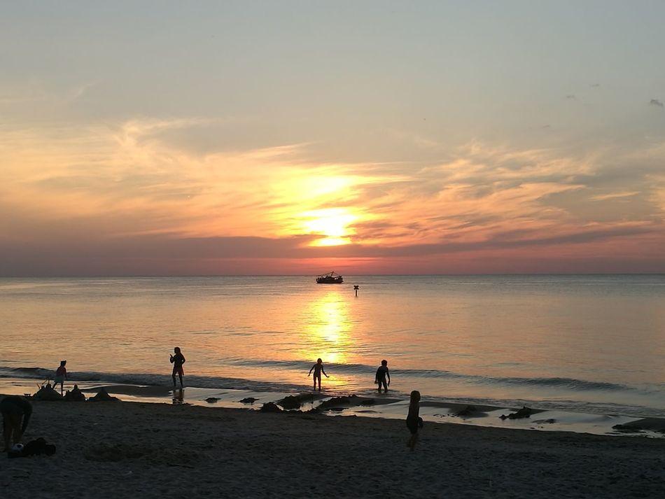 LoveSea Sunset Beach Sky Thebestview Loveit Loveit❤ Thisisit Everydayatsea Myworld Silhouette Sea Sun Water Sand Vacations Reflection Horizon Over Water Dramatic Sky Sunny Sunlight Nature Full Length Cloud - Sky Tranquility