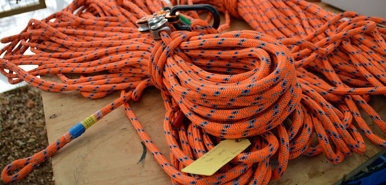 bundle of orange climbing rope ACDSee Bundle Bundled Up Climbing Climbing Trees Close-up Day Eindhoven Heap Maintenance Maintenance Work Nature No People Orange Color Outdoors Rope Stack Tools Tree Maintenance Wasven