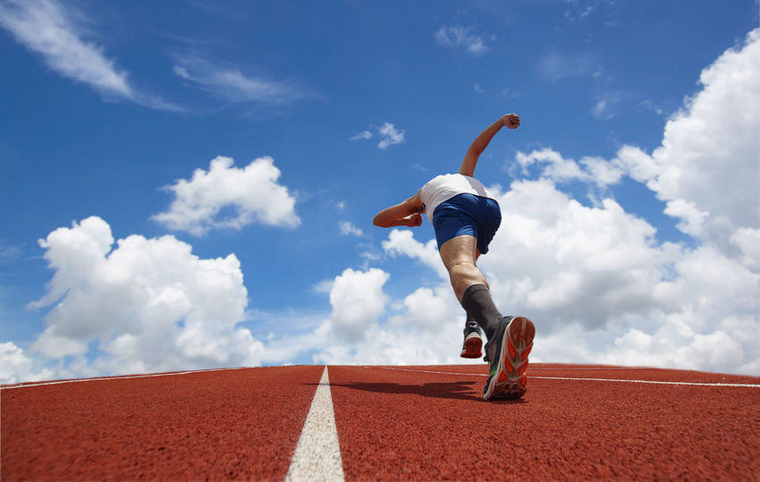 Start running in track Balance Blue Cloud - Sky Competition Day Exercising Full Length Low Angle View Men Men's Track Motion One Man Only One Person Outdoors Running Running Track Sky Speed Sport Sports Race Sports Track Sprinting Track And Field Track And Field Athlete Track Event