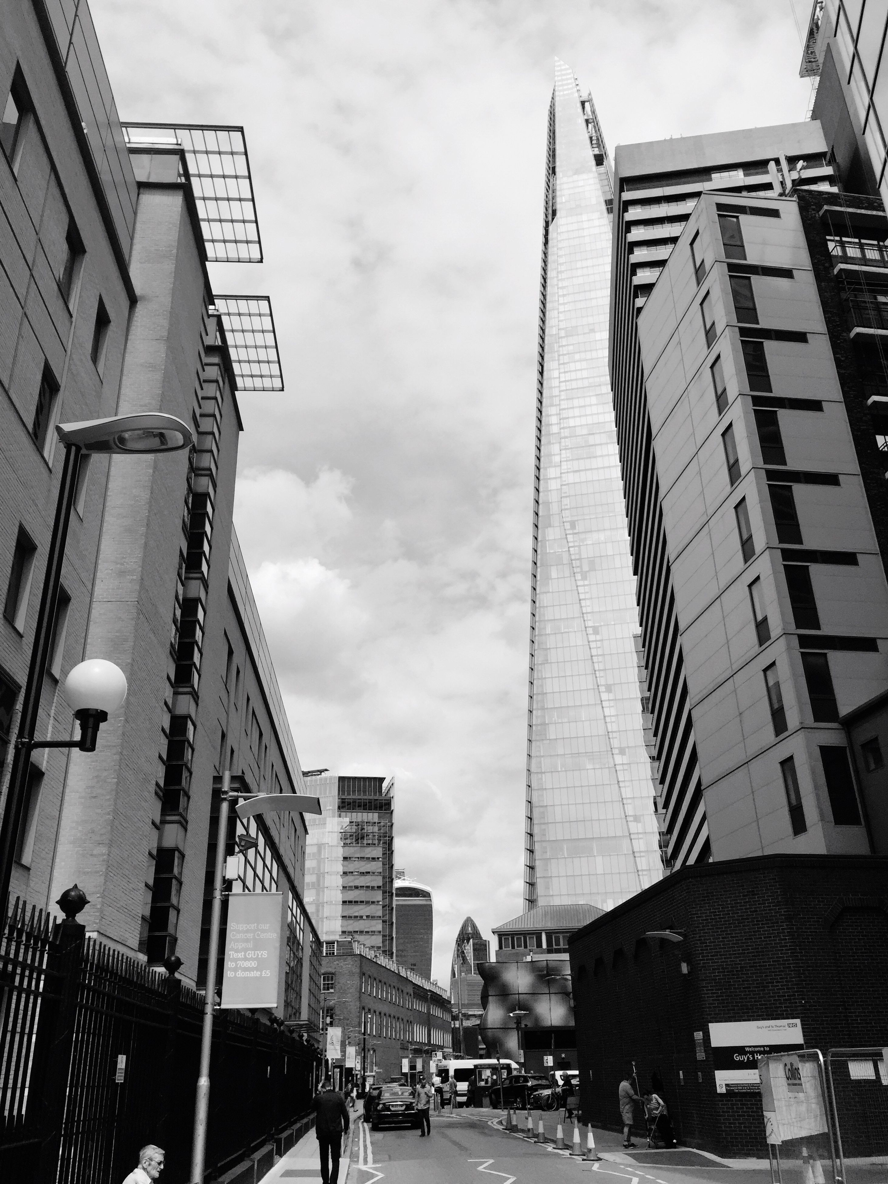 architecture, building exterior, built structure, city, sky, low angle view, skyscraper, travel destinations, outdoors, cloud - sky, city life, day, modern, no people, cityscape