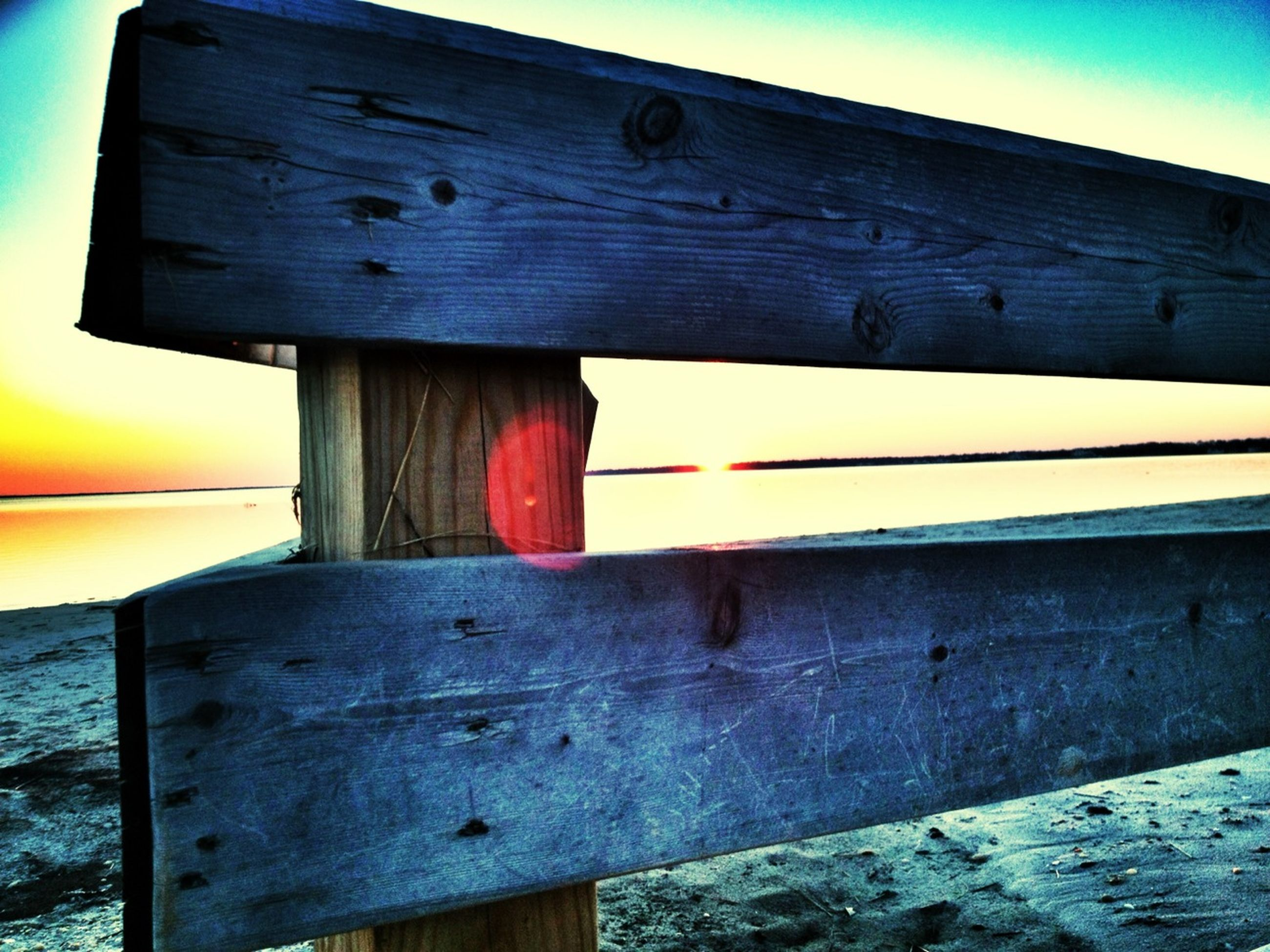 built structure, architecture, building exterior, wood - material, blue, wooden, low angle view, safety, protection, weathered, railing, sky, yellow, outdoors, wood, no people, old, sea, house, security