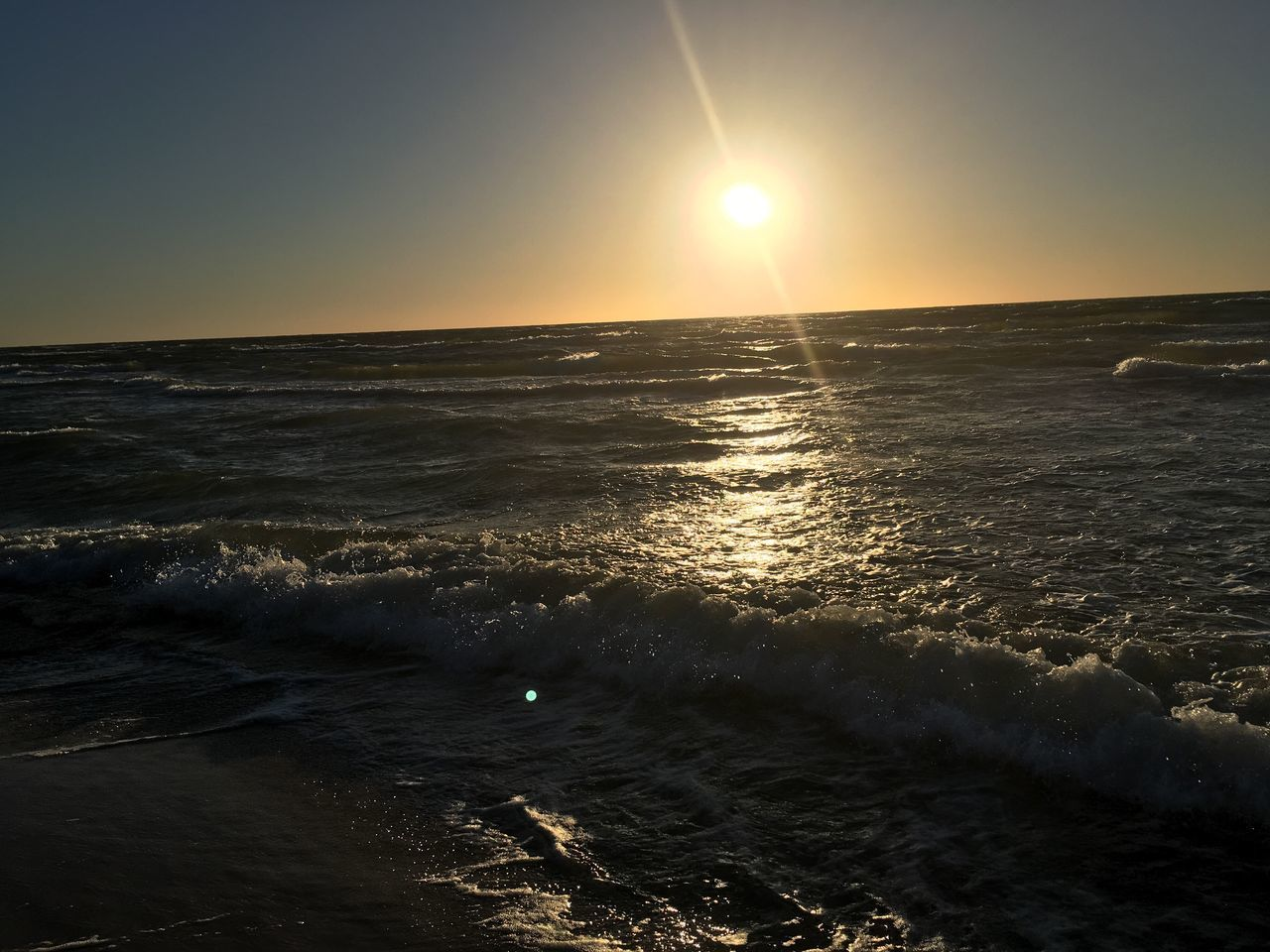 sea, sunset, sun, beauty in nature, scenics, nature, horizon over water, water, tranquility, tranquil scene, sunlight, sky, idyllic, no people, outdoors, silhouette, waterfront, clear sky, beach, wave, day
