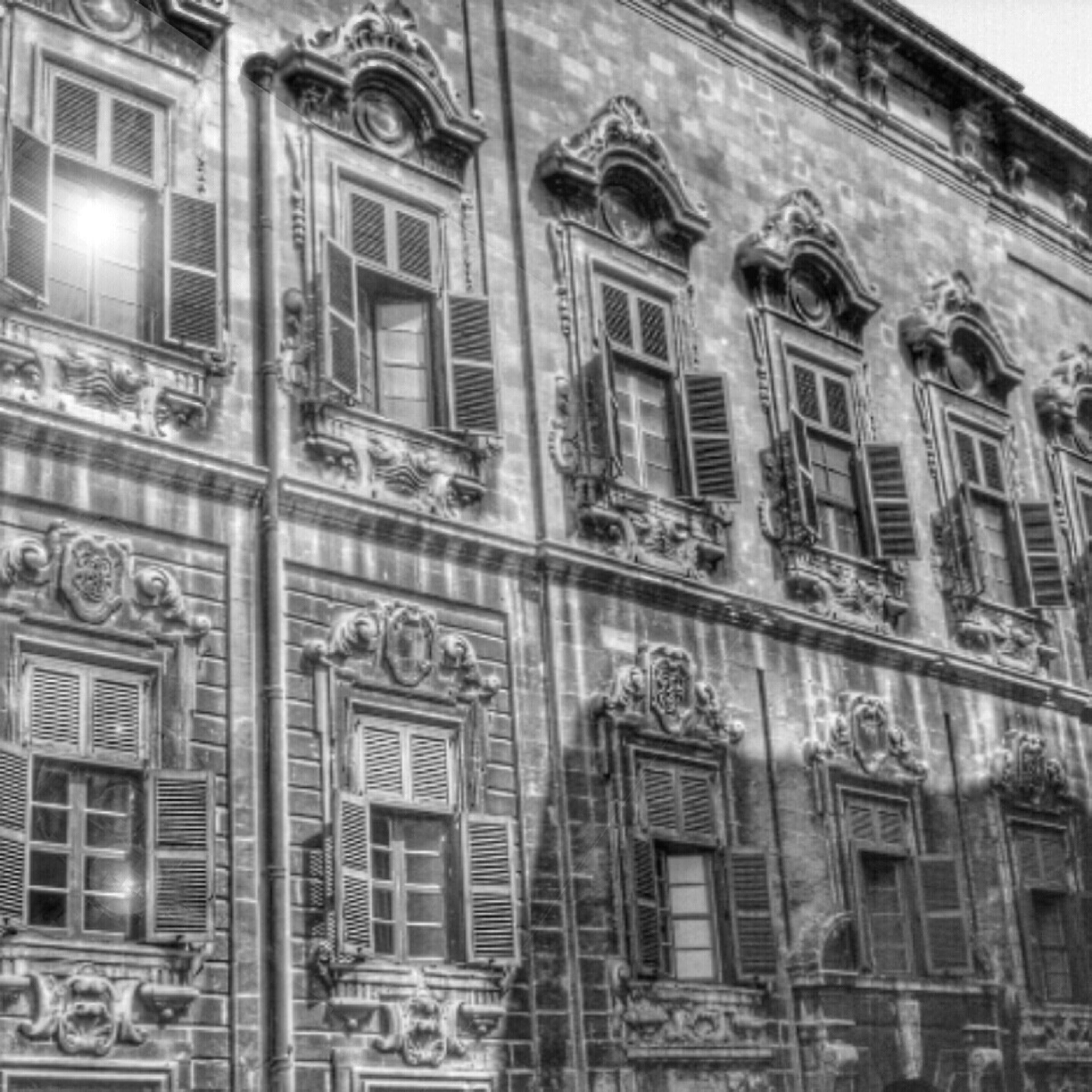 building exterior, architecture, window, built structure, low angle view, building, residential building, glass - material, residential structure, city, balcony, day, facade, outdoors, old, full frame, reflection, no people, in a row, side by side