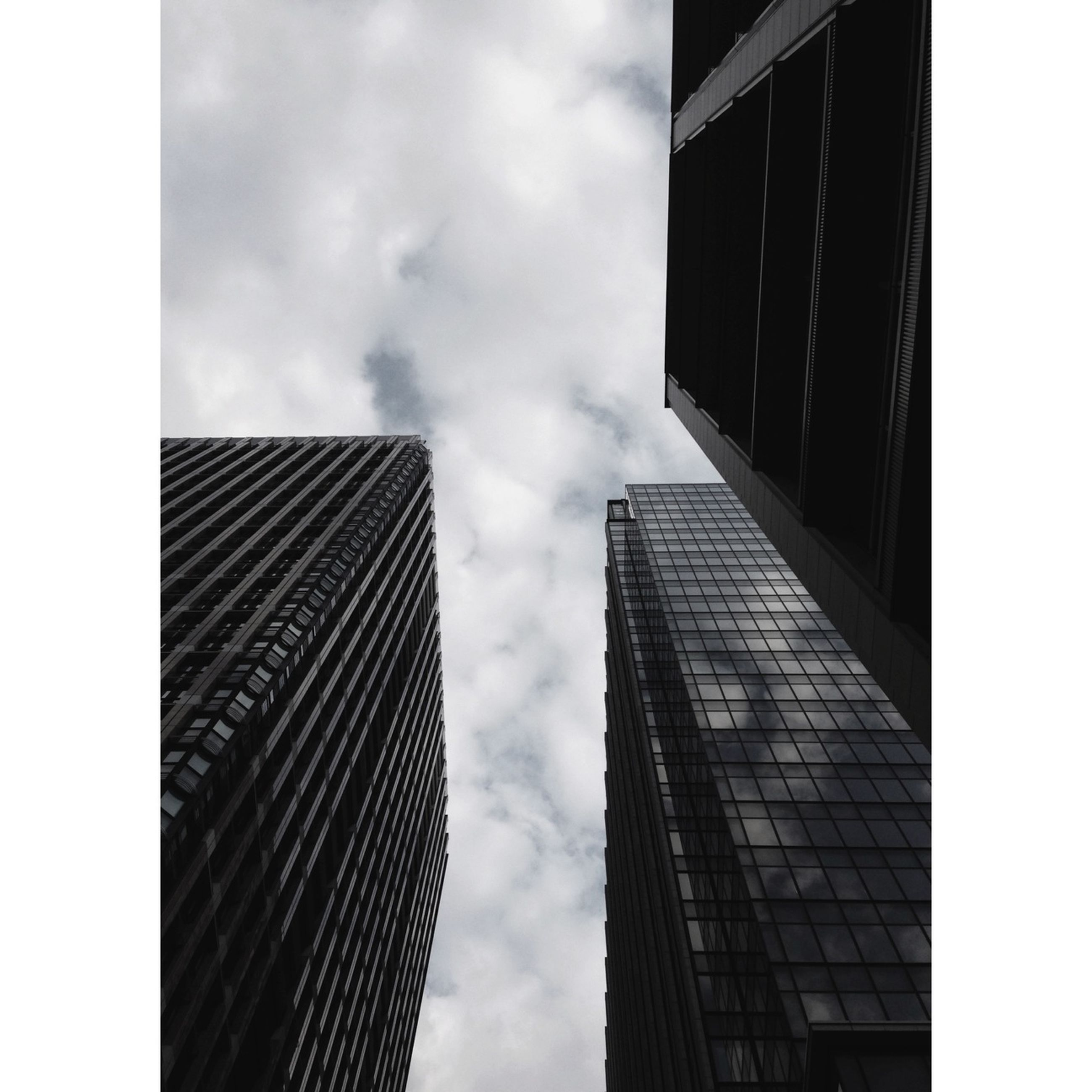 architecture, building exterior, built structure, low angle view, modern, office building, sky, skyscraper, city, tall - high, tower, building, glass - material, cloud - sky, reflection, tall, auto post production filter, window, directly below, cloud