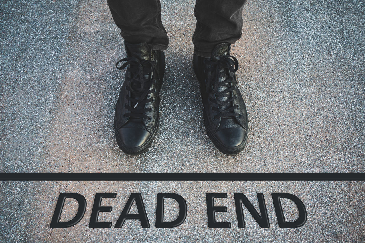 Business Path Young Businessman Communication Day Dead End End Final Finnish  High Angle View Human Body Part Human Leg Issues Low Section Men One Man Only One Person Outdoors Problem Real People Shoe Standing Terminal Text