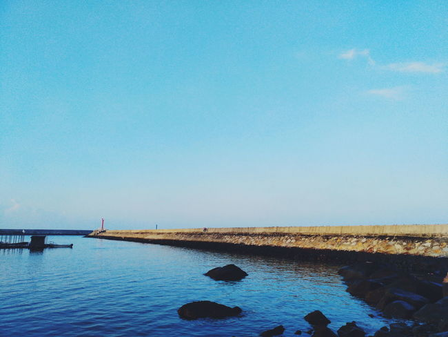 Water Copy Space Tranquil Scene Blue Tranquility Sea Scenics Calm Rock - Object Clear Sky Beauty In Nature Nature Ocean Day Waterfront Outdoors Non-urban Scene Summer Sky No People
