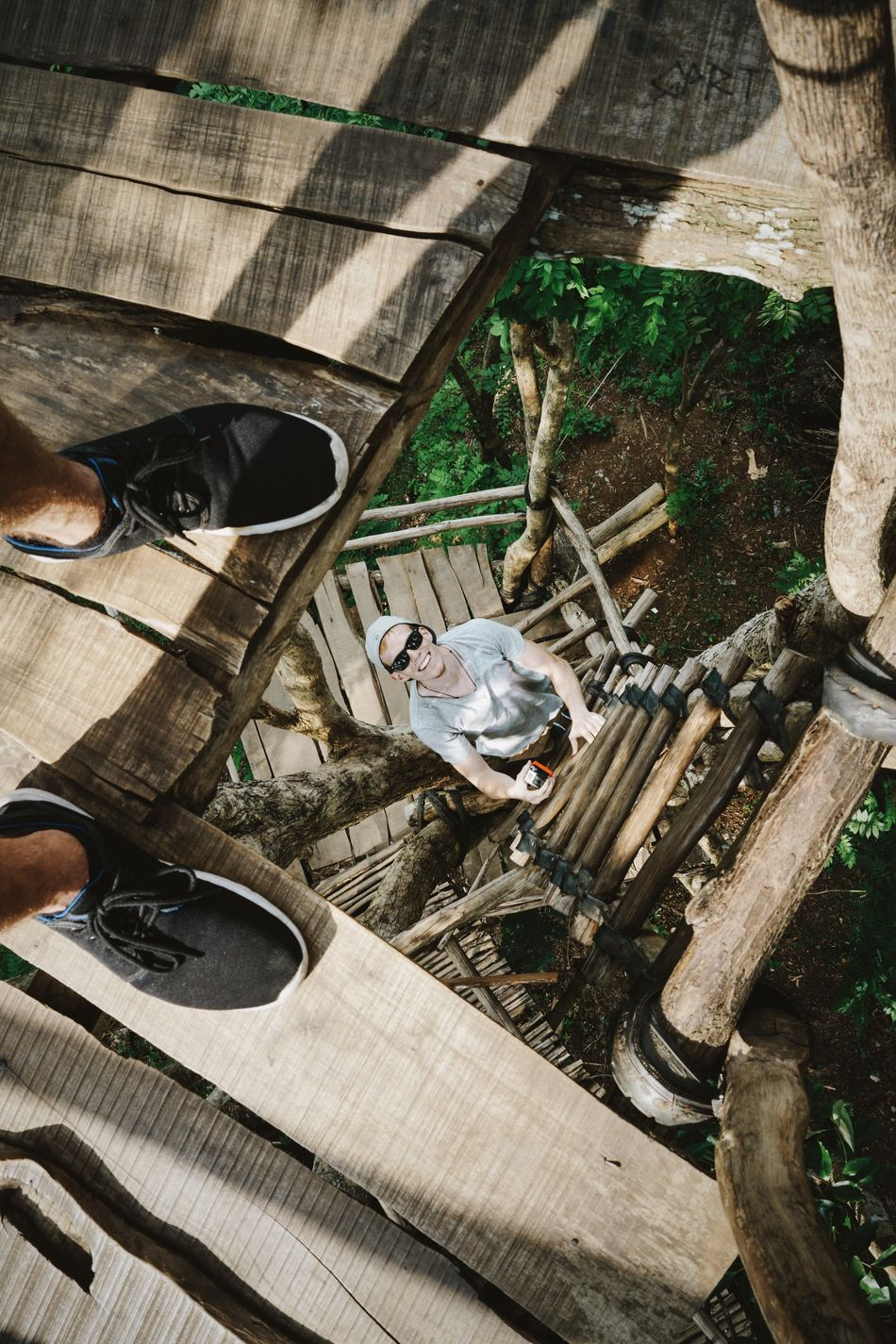 Exploring Jogja's surroundings Pine Forest Climbing Wooden Platform Man Smiling Sunglasses From My Point Of View Black Shoes Grey T-shirt Looking Down Feet Wood Wooden Planks Forest INDONESIA Java Traveling Adventure My Year My View
