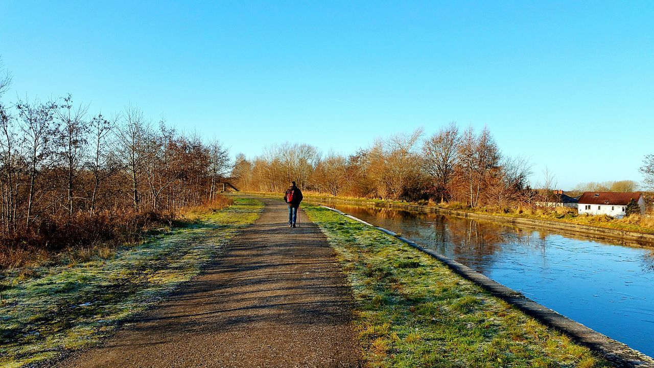 Canal Canals And Waterways Canal Walks Blue Sky Sky Clear Sky One Person Outdoors Adult One Man Only Pennington Flash Scenics Water Femalephotographerofthemonth Hubster