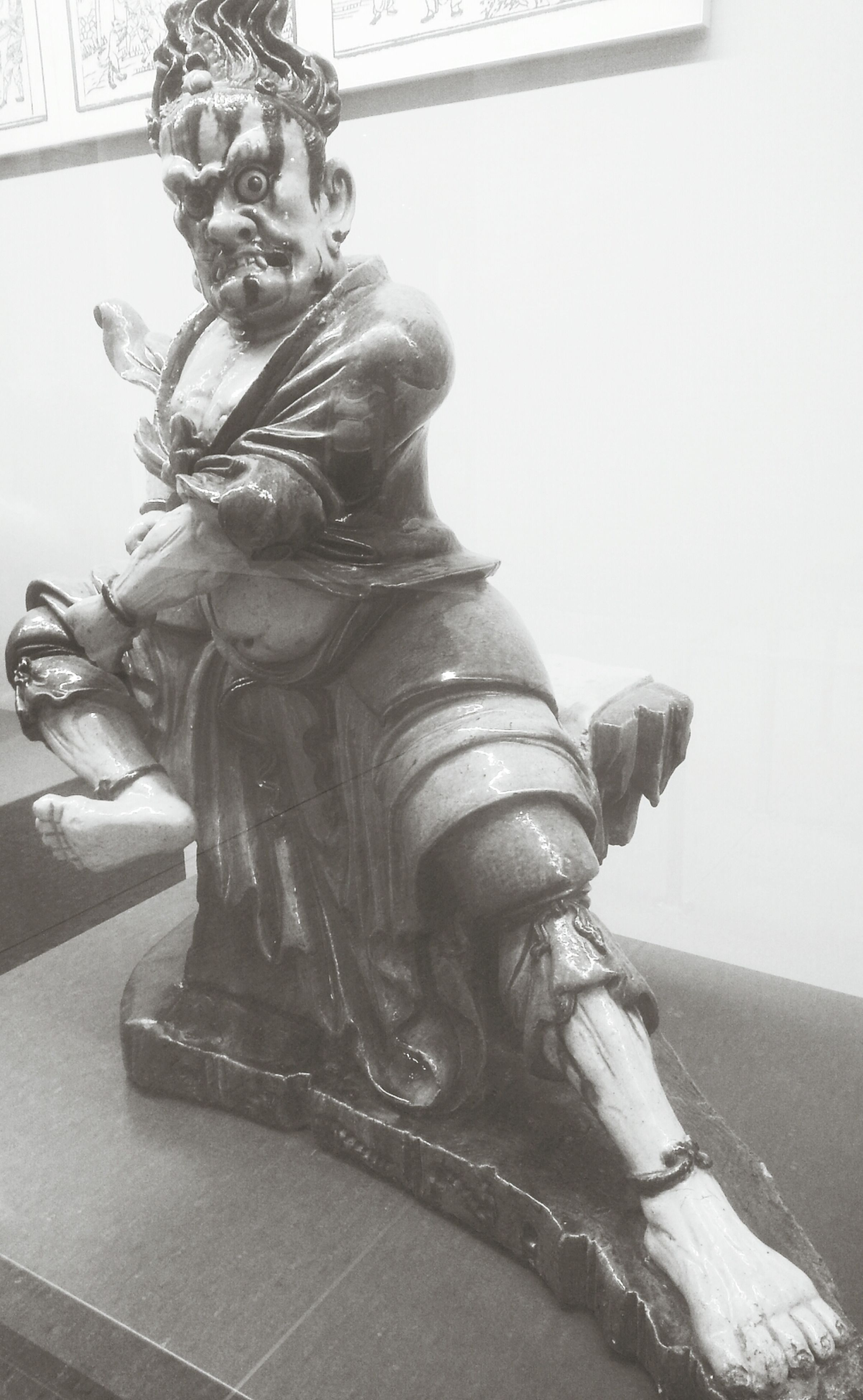 statue, human representation, sculpture, indoors, art and craft, art, creativity, animal representation, architecture, low angle view, craft, no people, built structure, wall - building feature, home interior, close-up, carving - craft product, sunlight