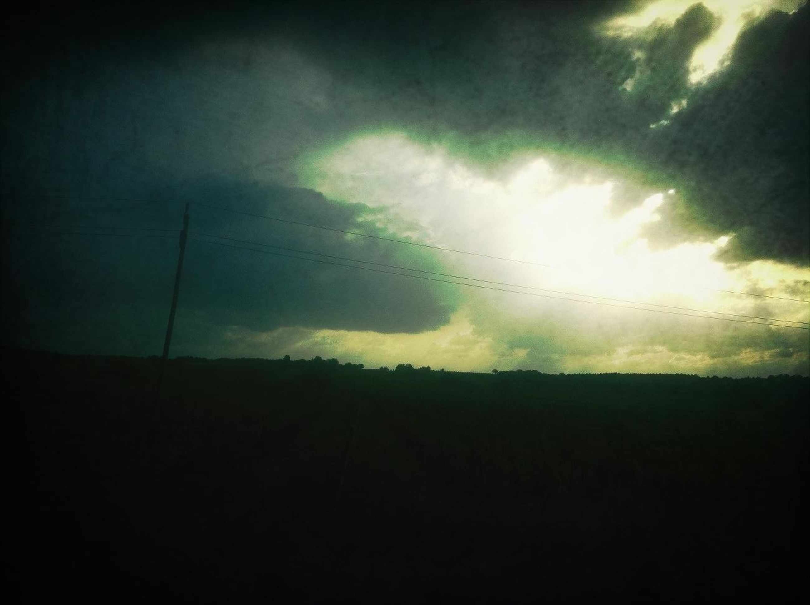 sky, silhouette, cloud - sky, scenics, landscape, tranquil scene, cloudy, tranquility, dark, beauty in nature, low angle view, weather, nature, storm cloud, overcast, dramatic sky, cloud, dusk, copy space, outdoors