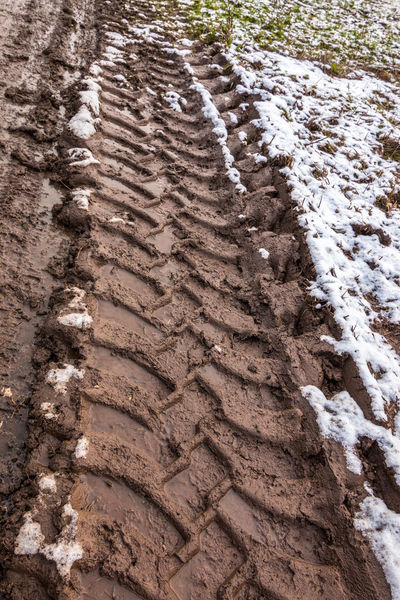Tire track in the muddy ground Agrarian Agriculture Farmer Farmland Tractor Winter Agricultural Agricultural Land Agricultural Productivity Farming Fertile Snow Tire Marks Tire Track Tire Tracks Tractors
