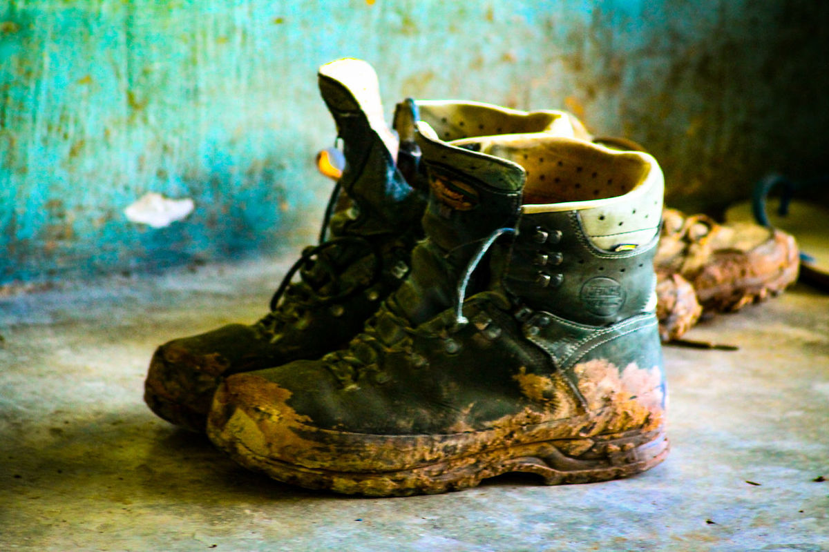 Faithful companion. Muddy Hiking Boots Footwear Outdoor Gears Travel Travel Essentials Trekking Dirt And Grime Muddy Boots Still Life
