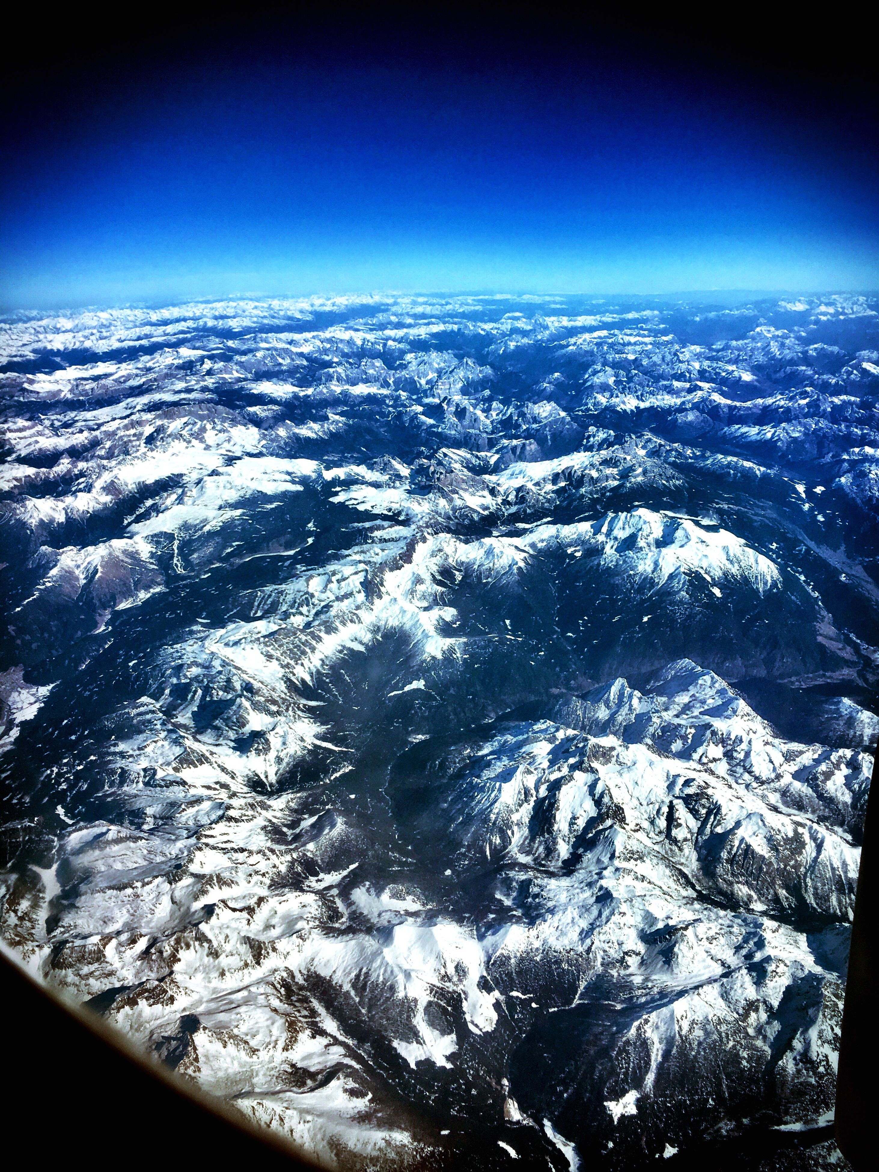 nature, aerial view, scenics, beauty in nature, blue, tranquil scene, non-urban scene, landscape, tranquility, no people, extreme terrain, airplane, backgrounds, outdoors, mountain, sky, day, close-up