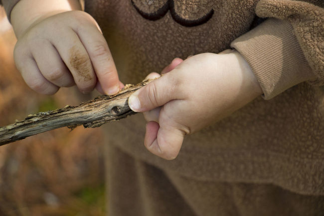 Peeling just a little bit to see what is underneath. Bark Branch Childhood Close-up Cropped Dirty Fingers Discovery Dramatic Angles Extreme Close Up Focus On Foreground Hands Holding Human Finger Investigation Discovery Nature Part Of Peeling Off Person Personal Perspective Stick Still Life Toddler  Twig