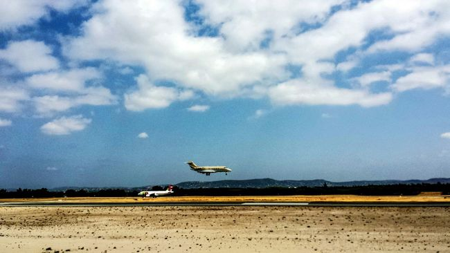 Planespotting Coming in hot The Traveler - 2015 EyeEm Awards Algarve Airport Airplane Landing Runway Sunshine Southern Europe Europe Outdoors Portugese Morning Blue Sky Sky Travel Clouds