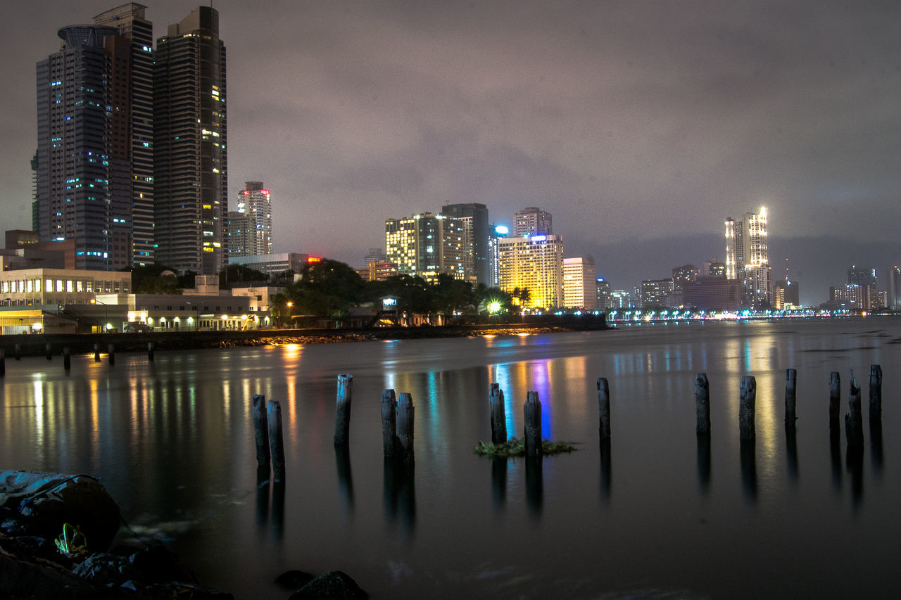 architecture, illuminated, building exterior, skyscraper, built structure, sky, night, water, reflection, city, modern, no people, travel destinations, outdoors, cityscape, urban skyline, nature