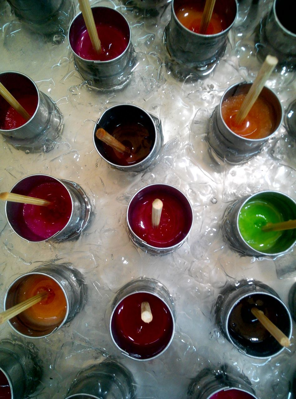 no people, indoors, high angle view, variation, multi colored, choice, large group of objects, drinking glass, liquid, close-up, alcohol, day
