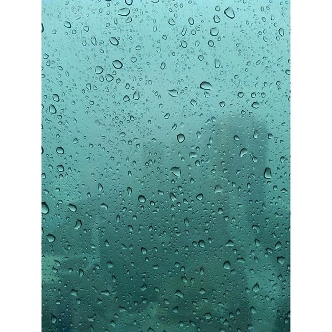 Here cones the Rain Raindrops Glass Officelife LovelyRain Manila Makati Metropolitan MetroManila Philippines ItsMoreFunInPhilippines summerchill