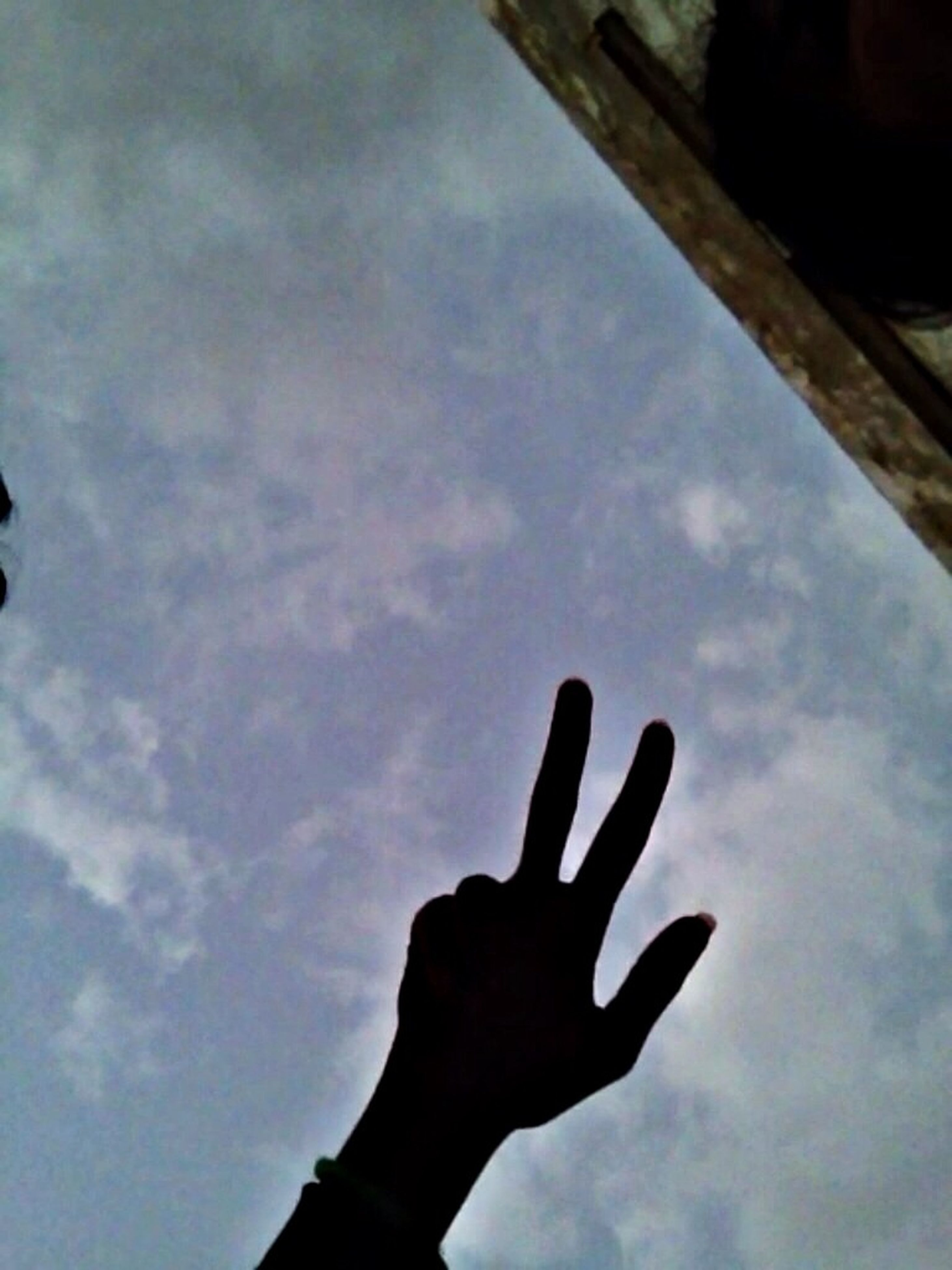 person, part of, low angle view, sky, personal perspective, human finger, cropped, holding, cloud - sky, unrecognizable person, cloud, silhouette, lifestyles, men, built structure, leisure activity, cloudy