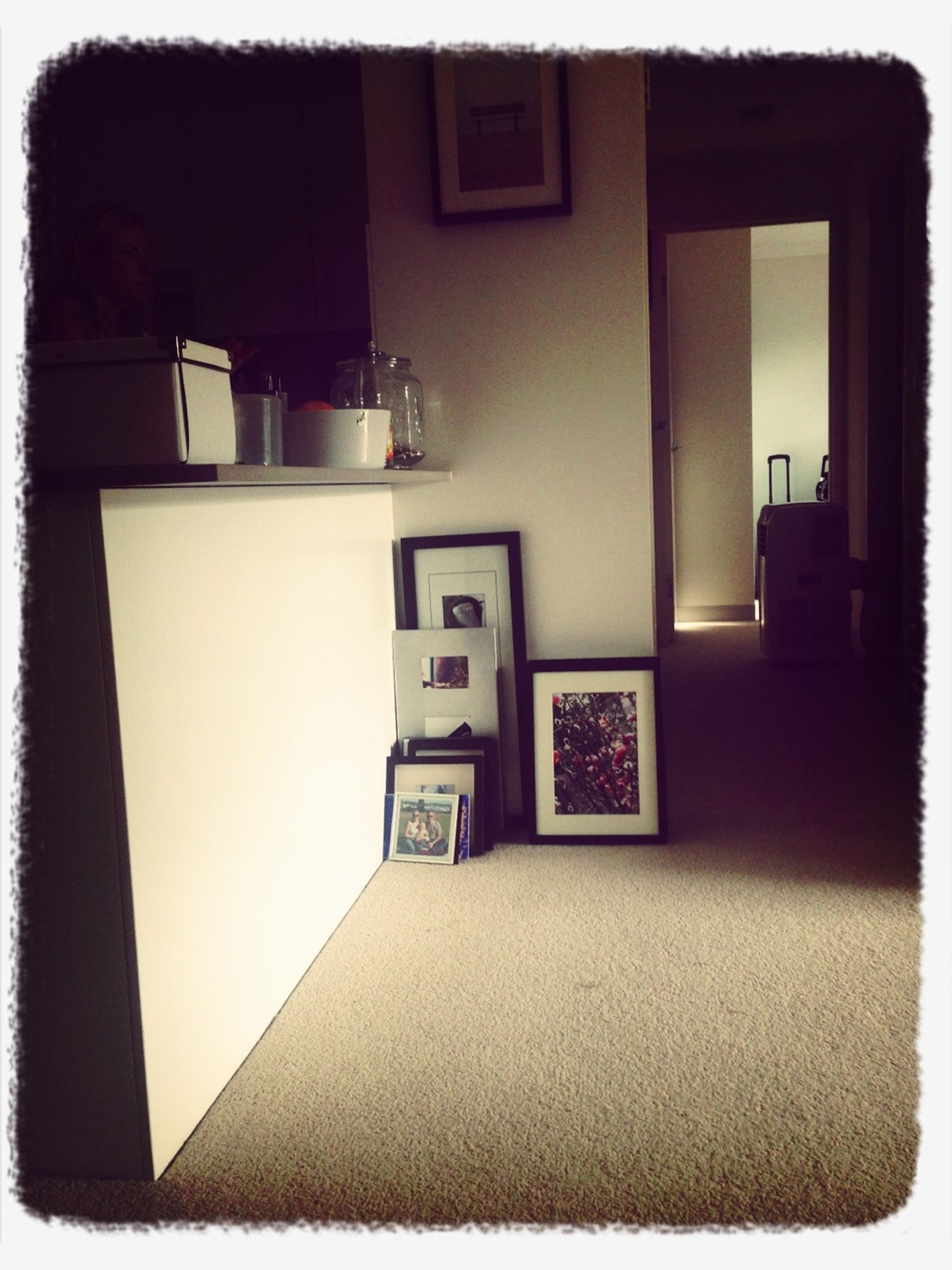 indoors, table, home interior, transfer print, chair, auto post production filter, absence, picture frame, empty, window, still life, technology, house, domestic room, no people, communication, room, living room, laptop, architecture